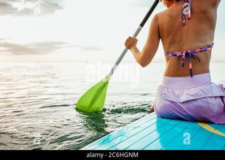 Woman On A Stand-Up Paddle - Stock Photo