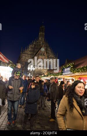 Nuremberg/Germany - December 21, 2019: Christkindlesmarkt in Nuremberg, Germany. The annual Christmas market takes place during Advent in Nuremberg. - Stock Photo