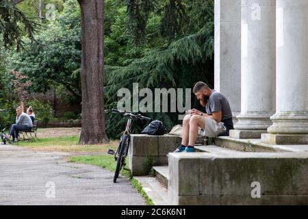 London, UK. 10th July, 2020. A man sits on some steps in the evening. Credit: Liam Asman/Alamy Live News - Stock Photo