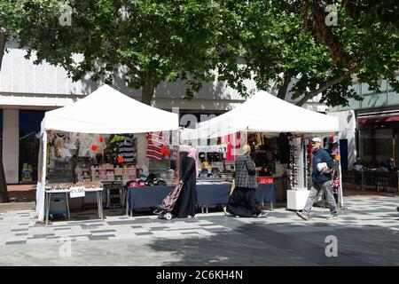 Slough, Berkshire, UK. 10th July, 2020. Customers at a street market stall selling face masks and face coverings in Slough High Street. Many people in Slough are wearing face masks whilst out shopping. Credit: Maureen McLean/Alamy - Stock Photo
