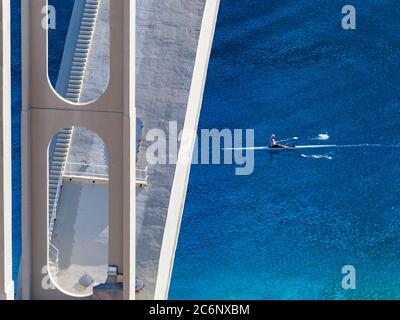 Kayak single one boat passing under bridge mainland to Krk island in Croatia Europe - Stock Photo