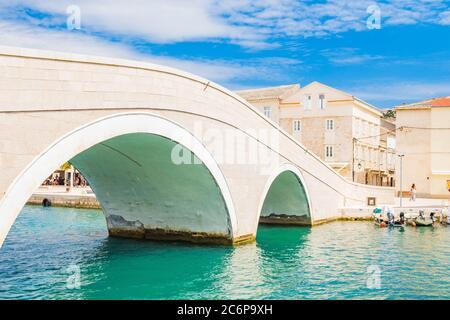 Beautiful town of Pag in Dalmatia, Croatia, view of marina and old stone bridge