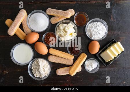 Tiramisu Cake Ingredients: Ladyfinger cookies, espresso powder, and other ingredients to make a cake version of the classic Italian dessert - Stock Photo
