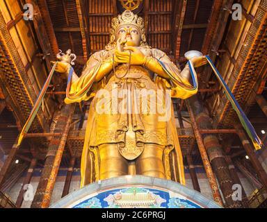 ULAANBAATAR, MONGOLIA - JULY 12, 2016: Avalokitesvara statue inside the Gandantegchinlen or Gandan Monastery. Its a Tibetan Buddhist monastery in the - Stock Photo