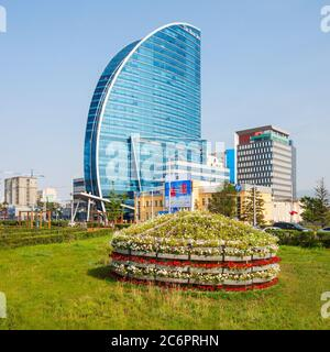 ULAANBAATAR, MONGOLIA - JULY 12, 2016: The Blue Sky Tower is located in Ulaanbaatar, Mongolia. The skyscraper is used as office space, conferences, a - Stock Photo