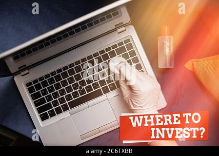 Writing note showing Where To Invest Question. Business concept for fundraising money to start business project startup Contaminated electronic gadget - Stock Photo