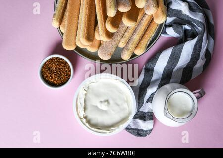 cooking Italian Dessert with cocoa, coffee and mascarpone cheese Tiramisu and all the necessary food ingredients and utensils. step by step - Stock Photo