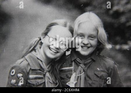 Fine 70s vintage black and white lifestyle photography of girls spending time at girl scout camp. - Stock Photo