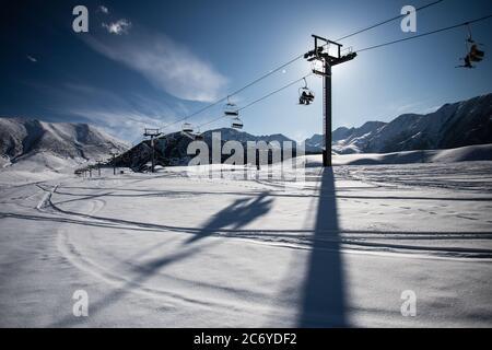 Tourists and sportsmen explore the pistes of Chunkurchak Ski Base in the Chuy Oblast of Kyrgyzstan near Bishkek.