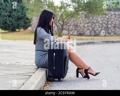 Aka young woman legs heels - Stock Photo