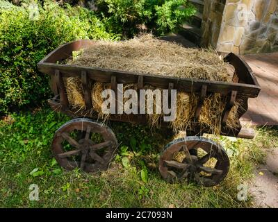 A wooden bench sitting in the grass