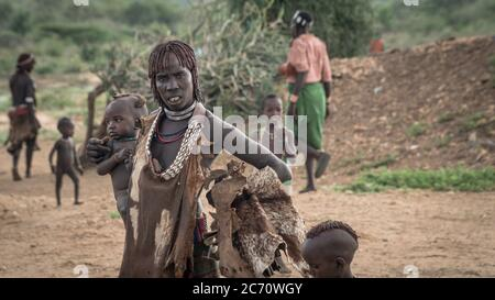 Omo Valley, Ethiopia - September 2017: Unidentified woman with her baby from the tribe of Hamar in the Omo Valley of Ethiopia - Stock Photo