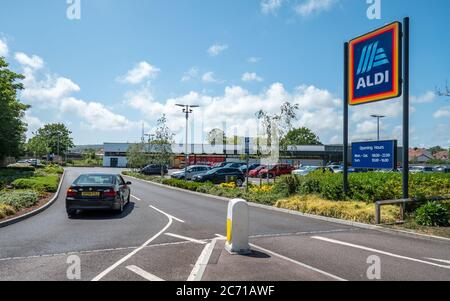 Aldi Supermarket. A car entering the supermarket retailer, Aldi, on a bright day in the East Sussex town of Eastbourne, England.