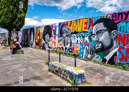 Graffiti wall at Mauerpark, Berlin. Paintings of clack heroesMalcolm X, Martin Luther King & Angela Davis. Black Lives Matter - Stock Photo