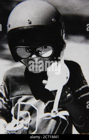 Fine 70s vintage black and white lifestyle photography of a boy wearing a super cool biking helmet. - Stock Photo