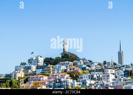California, CA, Western, San Francisco, Telegraph Hill neighborhood, Coit Tower, skylineart deco, building, clear blue sky, Arthur Brown, Henry Howard - Stock Photo