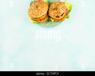 Vegan vegetable burgers with spelt buns - Stock Photo
