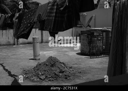 A black and white picture of clothes hanging dry in a laundry line