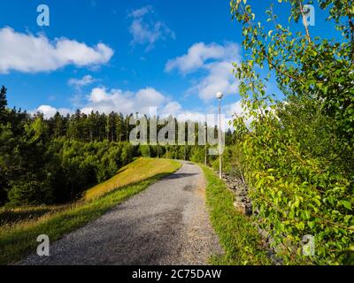 Dam promenate road on lake Lepenica near Fuzine in Croatia Europe - Stock Photo
