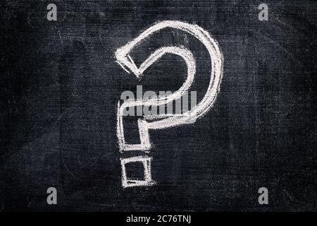 Question mark on school blackboard, questioning symbol written in chalk - Stock Photo
