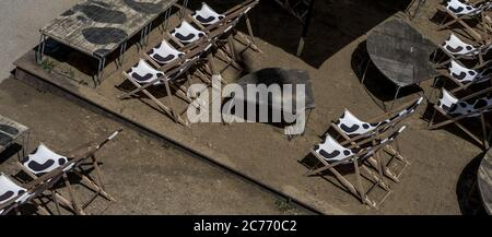 Abandoned Beach Bar With Empty Deck Chairs During Corona Crisis - Stock Photo
