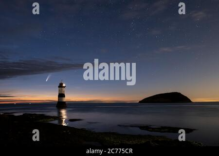 Comet NEOWISE and The Night Sky above Trwyn Du Lighthouse and Puffin Island, Penmon, Anglesey, North Wales, UK - Stock Photo