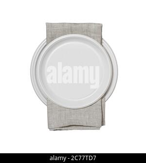 Plastic plates and serviette isolated on white background. - Stock Photo