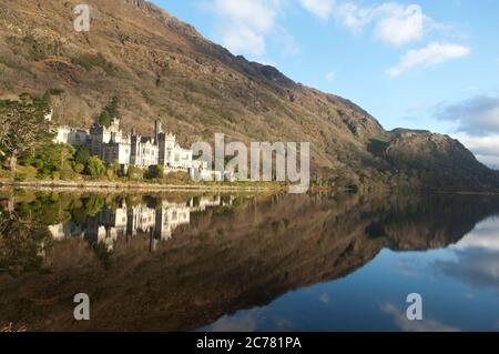 Kylemore Abbey, and lake, Connemara region, Ireland - Stock Photo