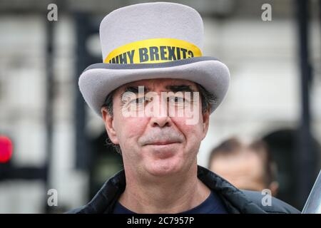 Westminster, London, UK. 15th July, 2020. Westminster 'Stop Brexit Man' Steven Bray. Pro European Anti Brexit protesters and campaigners around Steve (Steven) Bay hold their weekly protest outside the gates at the Houses of Parliament and in Parliament Square, Westminster as MP's hold PMQs inside the House of Commons. Credit: Imageplotter/Alamy Live News - Stock Photo