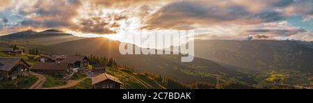 Aerial view of  small alpine mountain huts in the high alps of the grindelwald valley in Switzerland.