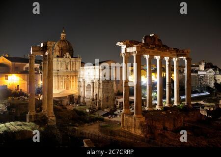 Temple of Saturn. Roman forum at night. Rome. Italy. - Stock Photo
