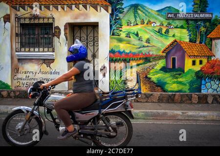 Motorbike and Wall street art graffiti in Salcoatitan Sonsonate El Salvador Central America. Ruta De Las Flores, Department Of Sonsonate.