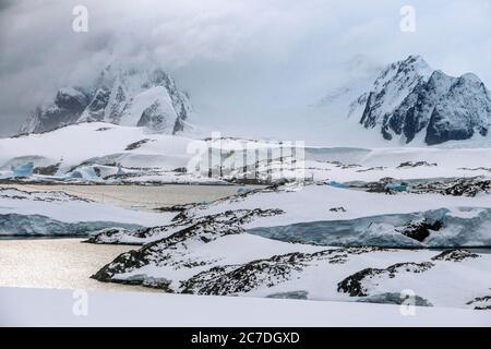 Landscape near Vernadsky research base, Ukrainian Antarctic station at Marina Point on Galindez Island in the Argentine Islands, Antarctica. - Stock Photo