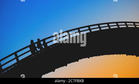 A low angle shot of the famous historic Kintaikyo Bridge in Iwakuni, Japan - Stock Photo