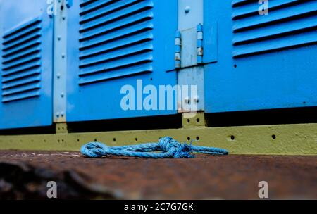 Shallow focus view of widespread rust seen by one of the steps on an old, abandoned diesel locomotive at a scrap yard. - Stock Photo