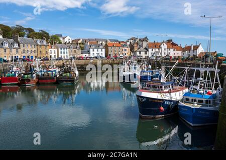 Fishing boats tied up in Pittenweem harbour in East Neuk of Fife, Scotland, UK