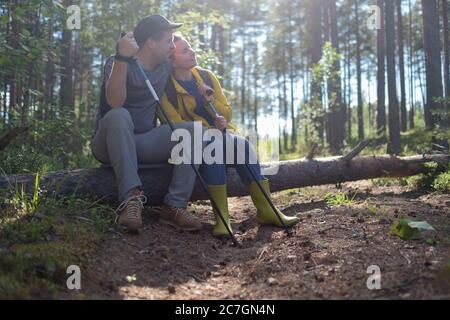 Couple in forest during hiking. Rest together. - Stock Photo
