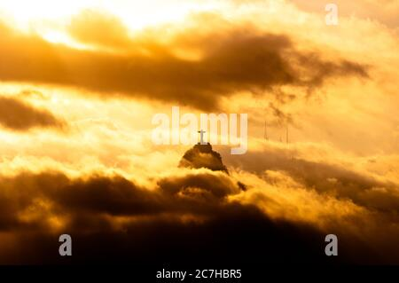 Corcovado Mountain with Christ the Redeemer in Clouds on Sunset, Rio de Janeiro, Brazil - Stock Photo
