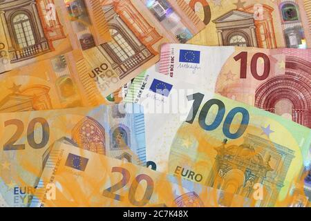 Symbol image: Burning euro notes (euro banknotes) as a symbol for waste of money - Stock Photo