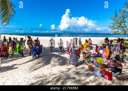 Souvenir shop assistants on Sakalava Beach, Oronjia National Park, Antsiranana, Diego Suarez, Madagascar, Africa, Indian Ocean - Stock Photo