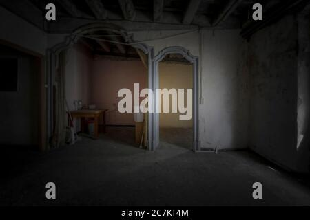interior of an apartment with abandoned walls, ceilings and floors in the center of a European city