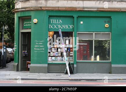 Edinburgh, Scotland - 30 July 2014: Green storefront of Tills Bookshop, a secondhand independent bookshop near The Meadows. - Stock Photo