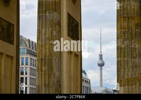 A view of Fernsehturm or TV Tower through Brandenburg Gate in Berlin, Germany