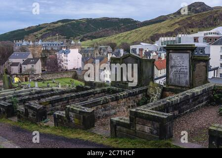 Old graves on New Calton Burial Ground on the southeast slopes of Calton Hill in Edinburgh, the capital of Scotland, part of United Kingdom - Stock Photo