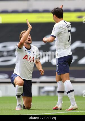 Tottenham Hotspur's Harry Kane (left) celebrates scoring his sides second goal with Son Heung-min during the Premier League match at the Tottenham Hotspur Stadium, London. - Stock Photo