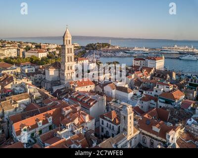 Split, Croatia - August 15 2019: A summer cityscape picture, with Diocletian's Palace, bell tower of cathedral of St Domnius & Riva promenade, evening