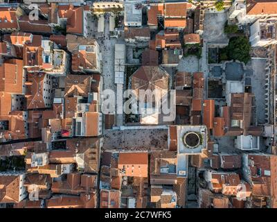 Split, Croatia - August 15 2019: A birds eye view of Split city centre showing Diocletian's Palace and the bell tower of the cathedral of St Domnius