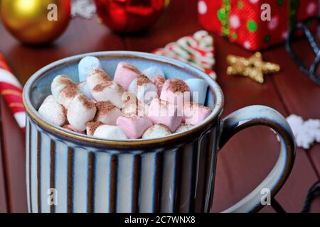 Hot chocolate in a mug on a wood table close-up