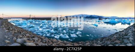 Beautifull landscape with floating icebergs in Jokulsarlon glacier lagoon at sunset. Location: Jokulsarlon glacial lagoon, Vatnajokull National Park, - Stock Photo