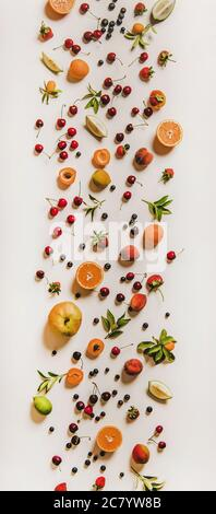 Flat-lay of various summer fruits and berries, vertical composition - Stock Photo